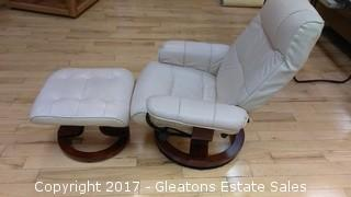 SWIRL LEATHER CHAIR AND OTTOMAN