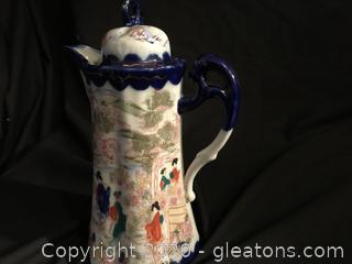 Oriental lidded pitcher pot