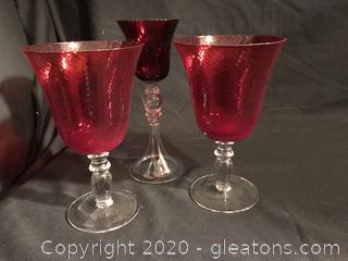 Three red crystal glasses