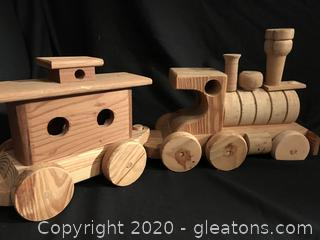 Sturdy wooden train engine and caboose
