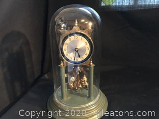 Brass and glass anniversary clock
