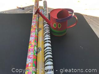 3 Rolls of Wrapping Paper & Child's Watering Bucket