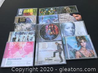 13 Varied CD's - Prince, Beyonce, Justin Timberlake, James Brown, John Legend +