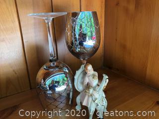 Elegant Wine Glass and Vintage Figurine