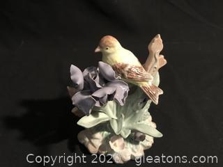 Porcelian goldfinch on iris
