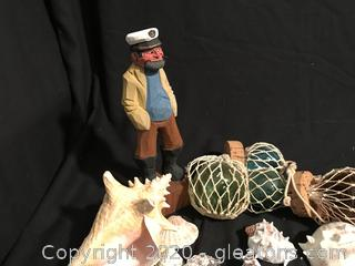 Carved wooden sea captain and his loot
