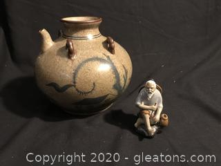 Oriental pot and Mud Mad Figure