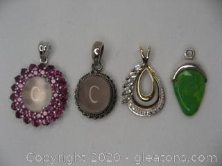 Four Sterling Pendants