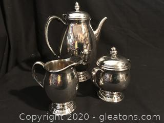 Tea pot, creamer and sugar