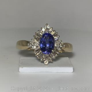 14K YG Oval Tanzanite W/Diamond Banquettes and Rounds