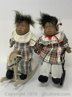Pair of Porcelain Dolls with Chair and Rocking Horse