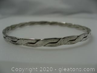 Sterling Silver Bangle Bracelet With Twist Design