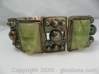 Sterling Silver Bracelet With Green Carved Stones.