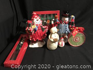 Snowmen figurines, coasters, butter knives and cake server