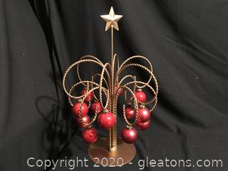Gold tree with red ornaments