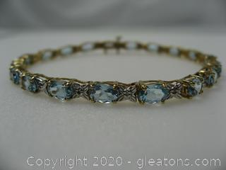 10kt Yellow Gold Blue Topaz and Diamond Bracelet