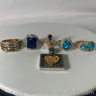 An Assortment of Five Ladies Fashion Rings and Pendant