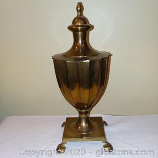A Brass Urn on a Pedestal with Lid