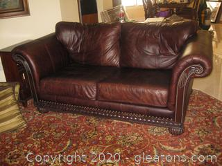 Rolled Arm Leather Loveseat with Wooden Base + Nail Head Trim