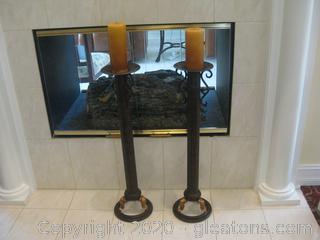 Pair of Tall Candlesticks on Circular Base