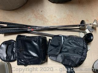 Lot of Golf Clubs and Golfing Coolers