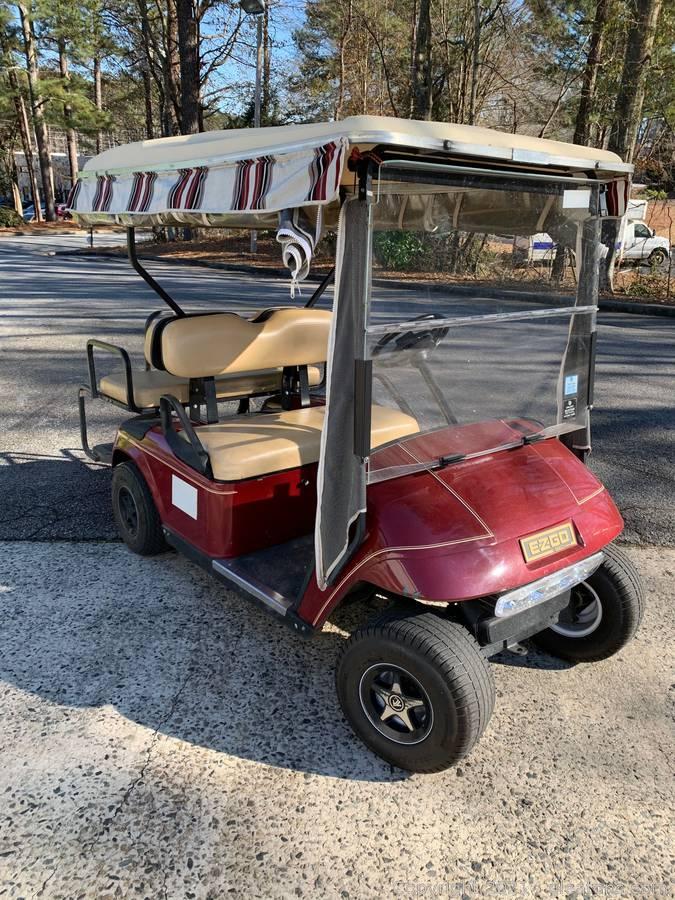 Nice E-Z-Go Textron Golf Cart with Sunbrella Enclosure