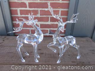 A Pair of Acrylic Reindeer / 1 is 14 inches at the tallest point / 1 is 11 3/4 inches to the tallest point