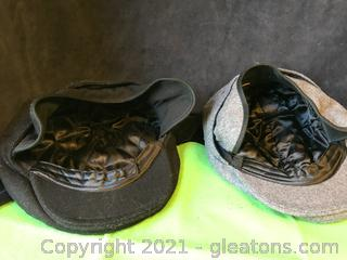 Two Dockers new boy-Cabbie hats, one black one Gray both with Ear Flaps