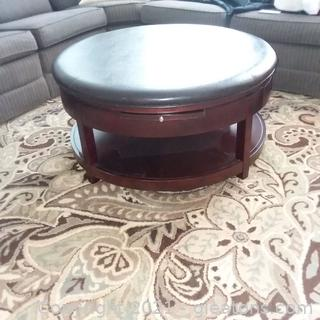 Round Leather Cushion Top Coffee/Cocktail Table (located in cottage 1)