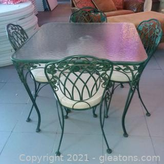 Leaf and Vine Wrought Iron Table and 4 Chairs (located in Event Center)