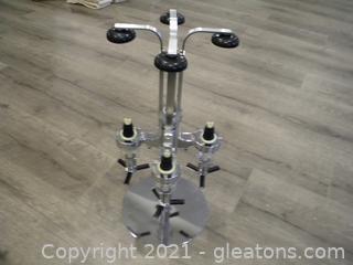 Rotating 4 bottle stand drink dispenser