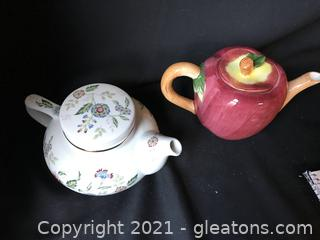 Two , 2 cup tea pots, white one is by Andrea by Sadek