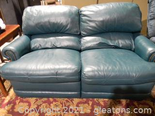 Faux Leather Reclining Loveseat