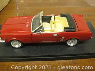 Die Cast 1:24 Scale Model of a Red Mustang Convertible