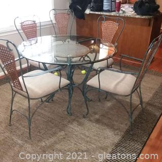 Glass Top Wrought Iron and Cane Table and 5 Chairs