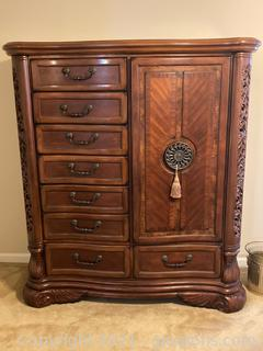 Exquisite Detailed Armoire.  Buyer may have to remove the stair banister to remove the furniture.
