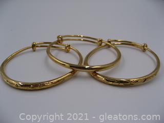 3 Gold Toned Stackable Bracelets