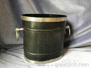 Black and silver metal trash waste can