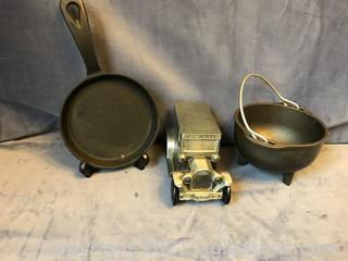 Cast iron lot, fry pan, pot and bank