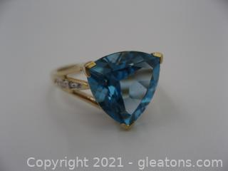 Beautiful 14kt Yellow Gold Blue Topaz and Diamond Ring