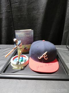 Autographed Hank Aaron Braves Baseball Cap, Action Figure and Book in Display Case
