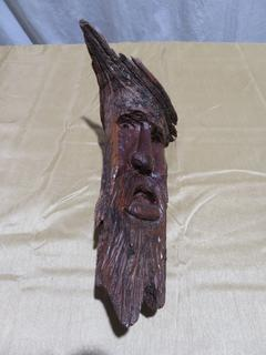 Hand Carved Man in a Tree