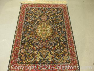Handwoven Low Pile Fringed Area Rug