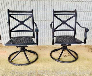 A Pair of Cast Aluminum Rocker Swivel Chairs
