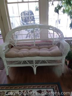 Pretty White Wicker Loveseat with Cushion