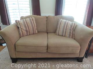 Charming Wood Trimmed Loveseat
