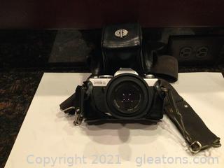 Minolta XG1. Camera with case