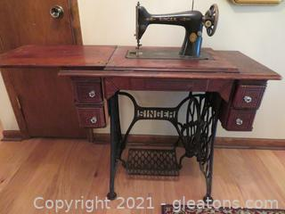 Vintage Singer Sewing Machine in Manual Pedal Cabinet