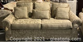 Gold Patterned Sofa with Six Pillows