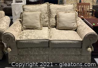 Gold Patterned Loveseat with Four Pillows